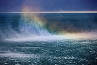 Rainbow in windblown spray