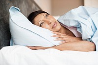 Woman laying in bed