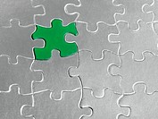 Green piece in silver jigsaw puzzle