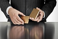 Businessman holding gold cards