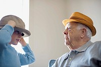 Grandfather wearing hat with grandson