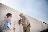 Grandfather playing baseball with grandson