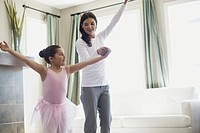 Mother dancing with daughter (thumbnail)