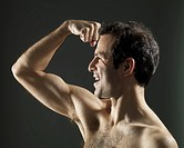 Man flexing arm