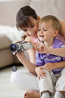 Mother showing son video camera (thumbnail)