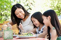 Mother and daughters having a healthy meal (thumbnail)
