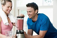 Couple making a post workout smoothie
