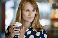Smiling woman holding coffee