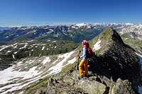 Woman enjoying view over Western Alps, Gotthard range, Canton of Ticino, Switzerland