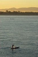 Fishermen on the river Mekong at sunrise, South Laos, Laos, Asia