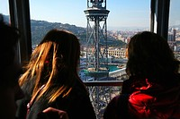 People inside the cable car over the port of Barcelona, Spain, Europe