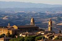 View over the roofs of Montalcino and the tower of the Palazzo Communale r. and the hills of Tuscany, Italy
