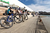Cyclists take a break at the seaside promenade, Namal section of Tel Aviv, Israel, Middle East