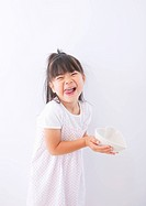 Girl holding a heart_shaped plate