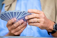 Senior man playing cards, close_up