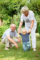Grandparents with toddler in garden