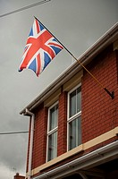 Union Jack flag flying outside terraced house in Oakengates, Telford, West Midlands, England UK