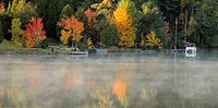 Autumn reflections in Clear Lake with light fog. Espanola, Ontario, Canada.