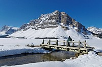 Crowfoot Mountain and frozen Bow Lake, Banff National Park, Alberta, Canada.