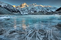 Dawn lights up Mt Sefton, reflection in frozen Mueller glacial lake, Aoraki / Mt Cook National Park. New Zealand.