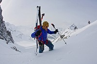 A man hiking with ski gear, Rogers Pass, Glacier National Park, British Columbia, Canada