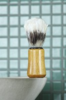 Close_up of shaving brush on bathroom sink