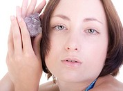 portrait of a younf woman holding an amethyst