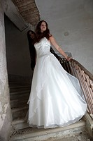 young woman in bridal dress in ruinous castle