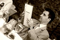 man reading the menu