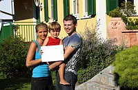 couple in front of newly bought house