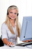 young woman with head set and computer at hotline