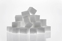 Many pieces of sugar to sweeten it isolated on a white background