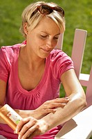 Woman using self tanning cream