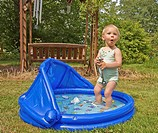 Age eighteen months , Attractive , Backyard , Bathing suit , Blond hair , Blow up pool , Blue eyes , Blue pool , Caucasian , Child , Cooling off , Cut...