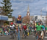 This editorial stock image are bike riders, the central person on a very tall bike, riding in the Saint Patrick's Day Parade This event was held on Ma...