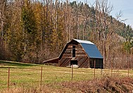 This old barn is in a pasture in springtime with wooded hills in the background This is located in Pend Oreille County in North Eastern Washington sta...