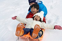 Boys and girl on a sled