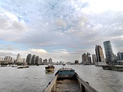 Barges going up the Huangpu River in Shanghai, China.