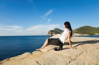 Portrait of a business woman relaxing in a cliff