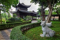 A statue of a dog in The Garden of the Chinese Zodiac.