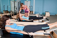 women practicing pilates