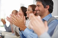 Happy business group of colleagues applauding