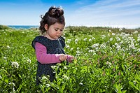 baby girl in field with flowers