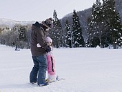 Child practices skiing