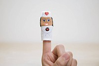 a woman´s hand wearing a finger doll.