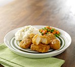 Chicken nuggets with mashed potatoes, pea/carrots