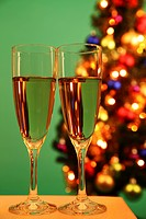 Champaign glasses with Christmas tree in background