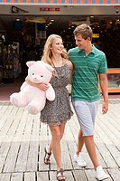 Teenage couple with teddy bear