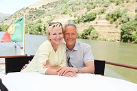 Senior couple enjoying a boat holiday