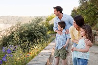 Family standing on rural lane on holiday (thumbnail)